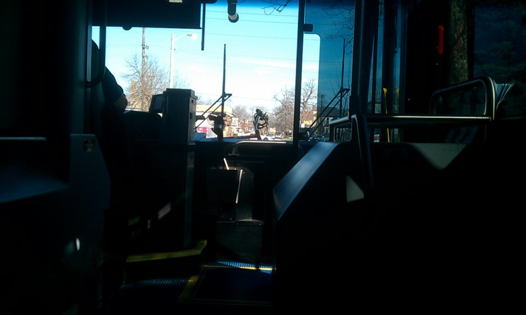 front of the bus with a view of my bicycle handlebars on the bike rack outside